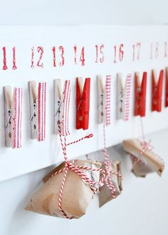 advent calendar with clips and little packages tied up with string.