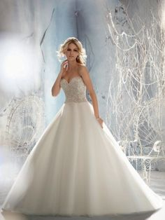 Mori Lee Style 1952, $1100 Mori Lee Wedding Dresses, Fall 2013. This princess-perfect ball gown of crystal beaded embroidery-on-tulle features a strapless sweetheart neckline, a sparkling beaded bodice and a full sweeping A-line skirt.