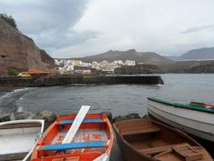 Colorful wooden boats in Playa de Sardina, Gran Canaria, Spain.