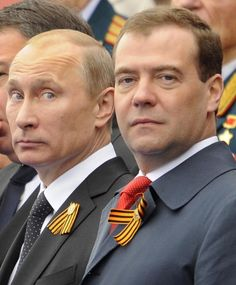 victory day in russia | Putin (C) and Prime Minister Dmitry Medvedev (R)attend the Victory Day ...