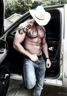 Sexy cowboy.  Man oh Man.  Muscles, ink and a cowboy hat?  Yeehaw!