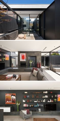 This modern house has a glass front door that opens to reveal an internal garden, and off to the side, is the living room, with a fireplace and a hearth that wraps around the wall into the kitchen. Floating shelves that are the same color as the wall sit above the television. #LivingRoom #Shelving #FrontDoor