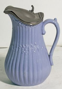 Ceramic Pitcher with Pewter lid. (Never seen one of these.)