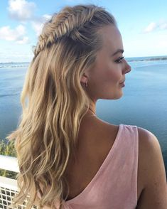 The best celebrity summer hairstles: Margot Robbie's side fishtail braid crown