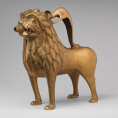 Aquamanile in the Form of a Lion, ca. 1200  North German  Copper alloy, glass inlay    10 1/2 x 4 9/16 x 10 13/16 in. (29.7 x 11.6 x 27.4 cm)  The Cloisters Collection, 1947 (47.101.52)