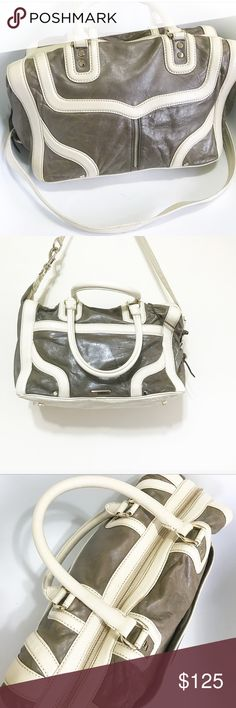 Rebecca Minkoff. Crossbody hobo satchel. Rebecca Minkoff purse. Dark golden brass color with ivory patent leather piping. Mint condition. Has a cross body strap. It's shaped like a hobo bag and can be carried like an arm tote. Very versatile. Rebecca Minkoff Bags Crossbody Bags