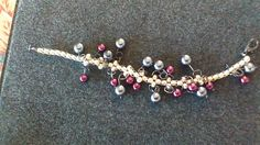 This is black and wine color glass beads woven bracelet