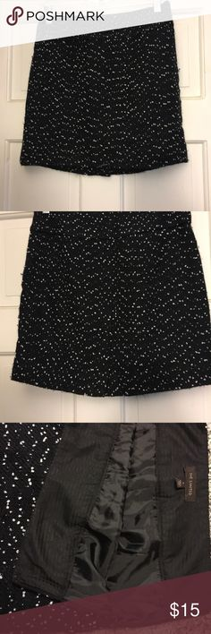 Wool skirt Black with white flecks wool skirt. Sits above the knee. Side zipper. The Limited Skirts Mini