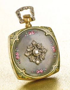 FERRERO A YELLOW GOLD, ENAMEL AND DIAMOND-SET CUSHION-FORM WATCH, RETAILED BY BAILEY BANKS BIDDLE CO. CIRCA 1900 • nickel lever movement, 18 jewels • silvered dial, stylized Arabic numerals • case back with translucent gray enamel over an engine-turned ground painted with small pink rosebuds, applied diamond-set decoration to the center, diamond-set bow • case and movement signed by maker and retailer, dial signed by retailer