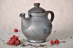 Clay kettle is a product of black smoke ceramics. Kilning technique, due to which dishes get its beautiful dark color, is famous since ancient times. Capacity of ceramic kettle is 1,5-2 liters. It's required to heat this kettle little by little, evenly, over the entire surface. Dimension:... see more details at https://bestselleroutlets.com/arts-crafts-sewing/crafting/ceramics-pottery/product-review-for-ceramic-kettle-with-lid/