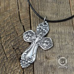 Here is a wonderful cross necklace just waiting to anoint your neckline. It was inspired by the beautiful patterns found on antique silverware. Ive used those Victorian influences along with a little bit of my own sculpting talent to create this piece. It looks like its made from spoons but