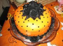 Beautiful orange halloween cake with black roses