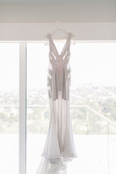 Wedding dress by J'Aton Couture: Hand-beaded with glass pearl and studded ceramic beads on a caged embroidered mesh.