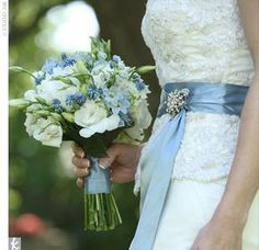 back to results popular searches Email Print Kristin's blue and white blooms included ivory ranunculuses and peonies.
