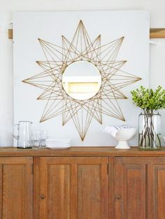 How pretty is this mirror? Create your own with just one spool of jute twine and a 14-inch round mirror.