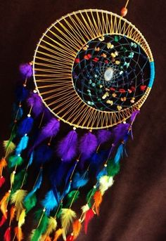 This is a Moon Motions TOP SELLER:) This is Moon Motions signature dream catcher but with a rainbow twist:) you still pick your moon color and core