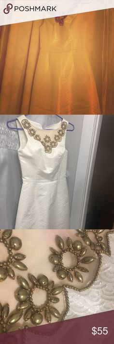 Lilly Pulitzer White and Gold Dress This fabulous dress will be hard to part with. Worn only once, it is just about NWOT. Size is 00. Can be worn with a regular bra. Comes above the knee. Scalloped print on dress. Lilly Pulitzer Dresses Mini