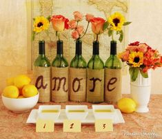 Wine bottle decor and flowers for Tuscan bridal shower theme.Love instead of Amore for a non themed bridal shower Italian Bridal Showers, Italian Themed Parties, Wine Bottle Crafts, Wine Bottles, Wine Decanter, Wine Parties, Bridal Shower Decorations, Italian Party Decorations, Shower Centerpieces
