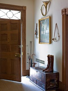 A conglomeration of an old trunk, riding boots, brass horn, old world painting and a beautiful wooden door create a beckoning welcome. Equestrian Decor, Equestrian Style, English Country Decor, English House, Cottage Interiors, House Painting, Decoration, Wooden Doors, Decor Styles
