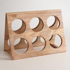 Display an array of wines in our rustic tabletop holder. This A-frame rack houses six bottles and is crafted of wood for a traditional look.