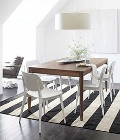 Olin Black Rug.  Use a rug to make a neutral or boring room back to life.  home decor.  interior decorating.  dining room.  bold stripes.