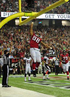 Tony Gonzalez #88 of the Atlanta Falcons celebrates after scoring a touchdown against the Denver Broncos at the Georgia Dome on September 17, 2012 in Atlanta, Georgia.