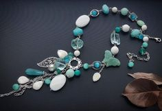 A long necklace with agate, quartz, chalcedony, cat's eye, mother of pearl, pearls, amazonite.