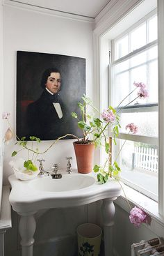 portrait above sink