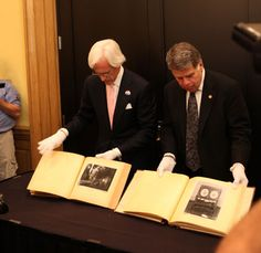 "Robert Edsel, President of the Monuments Men Foundation for the Preservation of Art (L) and Archivist David S. Ferriero (R) with donated ""Hitler Albums"" 7 and (Photo courtesy of the Monuments Men Foundation) Monument Men, National Archives, World War Ii, Investigations, Discovery, How To Find Out, Monuments, The Past, Novels"
