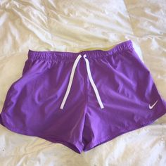 Nike dri-fit shorts Super cute and comphy Nike Dri fit shorts with built in  spandex for running. Lavender and yellow, a rare combo to find!!! Nike Shorts