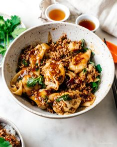 These spicy Sichuan turkey wontons in mapo sauce are a fun twist on wontons in red chili oil Asian Recipes, Healthy Recipes, Ethnic Recipes, Cooking Recipes, Chili Oil, Red Chili, Turkey Sauce, Wonton Recipes, Roasted Turkey