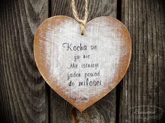 Heart with love-related quote, cut from plywood.