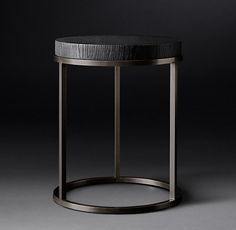 RH Modern's Nicholas Oak Round Side Table:Inspired by 1960s French design, our table by Anthony Cox combines the warm texture of wood with a minimalist sculptural form. Its solid oak top rests on a seamless metal frame in an artful pairing of contrasts.
