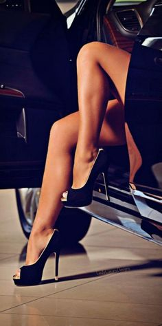 Sexy, glossy shot highlighting the shoes. I love the luxurious peek of the inside of the car. x