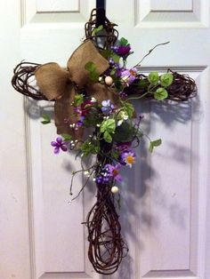 Grapevine cross with burlap bow by GracefulDesignsbyLiz on Etsy, $30.00