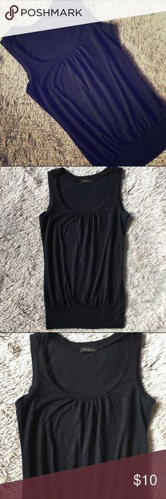 Scoop Neck Black Tank Scoop neck black tank. Billows out a touch around the tummy area then gets fitted at the hem. Classic tank. Light material. Perfect to wear to work on its own or with a blazer.  In very good condition 💕 Forever 21 Tops Tank Tops