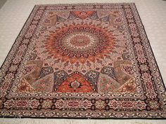 Tabriz rug - I have one with the same basic design...dome interior...but with a different color scheme.