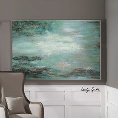 Restless Skies Wall Art is a hand-painted artwork on canvas that is stretched and attached to wooden stretching bars. A narrow, silver gallery frame encases the artwork. Due to the handcrafted nature of this artwork, each piece may have subtle differences. Designed by Carolyn Kinder International.