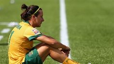 Lisa De Vanna #11 of Australia sits on the sideline after her teams 1-0 loss to Japan