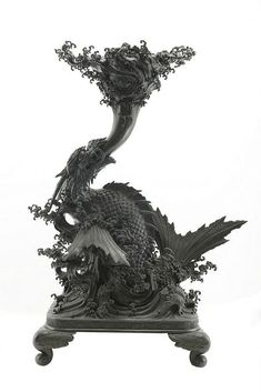 A large bronze dragon Japan, Meiji, 19th century A bronze sculpture in dark patina, very finely made and of exceptional dimensions.The dragon is depicted in the act of riding the waves.An interesting piece made on commission for a palace. h 180 cm