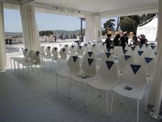 The multipurpose gazebo  for presentations, workshops  and prize awards with UNI chairs  from Metalmobil