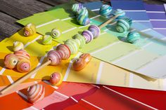 Paper beads from paint swatches. No instructions, make same as beads from magazines photos. LIZ