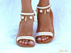 IMPORTANT: Please include a phone number at checkout, as its required by the carrier WE OFFER EXPRESS SHIPPING WORLDWIDE 1-4 DAYS WITH NO EXTRA CHARGE Handmade leather sandals made to order. Bride sandals, White Beach Wedding Sandals, Pearls sandals, Greek Sandal, barefoot sandal, Genuine