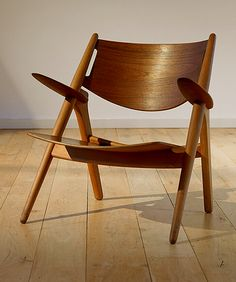 Very cool plywood armchair.  I like....Dope...!
