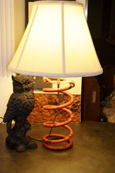 Upcycle Orange & Black Truck Spring Lamp by CatkinsCreations on Etsy ( I think it needs a metal punch hole shade or tinted shade )