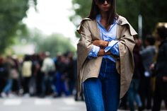 Natasha Goldenberg wearing a short trench coat and Levi's jeans before a show in Milan, Italy