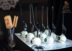What fun eyeball cake pops at this Halloween Party!! See more party ideas and share yours at CatchMyParty.com #halloween #cakepops