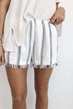 White Beach Short Vertical Denim Stripe Frayed Hem Elastic Waist Model is 5'9 Wearing Medium for Looser Fit