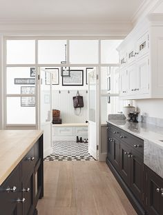 victorian influenced kitchen with black and white checked floor hall