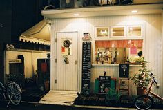 Cafe Lotta, Tokyo, Japan Okay I know it's a cafe but this would be a cute idea for a little outdoor eating bar that connects to the kitchen!